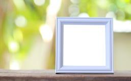 Nowożytna obrazek rama umieszczająca na drewnianej podłoga fotografia royalty free