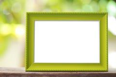 Nowożytna obrazek rama umieszczająca na drewnianej podłoga zdjęcie royalty free