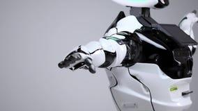 Nowożytne mechaniczne technologie Biały nowożytny robot w jaskrawym studiu Android taniec, falowanie jego ręki Demonstracja a zdjęcie wideo