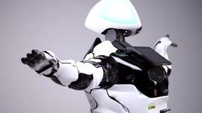 Nowożytne mechaniczne technologie Biały nowożytny robot w jaskrawym studiu Android taniec, falowanie jego ręki Demonstracja a zbiory