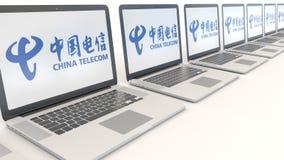 Nowożytni laptopy z China Telecom logem Informatyka artykułu wstępnego 3D konceptualny rendering Zdjęcie Stock