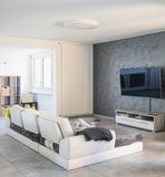Nowożytny żywy pokój z lekką kanapą zdjęcia stock