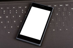 Nowożytny mądrze telefon komórkowy na płaskiej klawiaturze Obraz Royalty Free