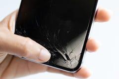 Nowożytny mobilny smartphone łamający ekran obraz stock
