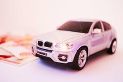 Nowożytny, modny samochód na białym tle, pieniądze Symbol sukces zdjęcia stock