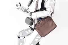 Nowożytny robot biega z torebką Obraz Royalty Free