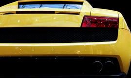 Nowożytny szybkiego samochodu zakończenia tło Luksus, drogi Fotografia Stock