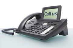 Nowożytny telefon na szklanym biurku Fotografia Royalty Free