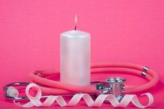 Nowotwór Piersi świadomości faborek z świeczka płomienia stetoskopem Obrazy Stock