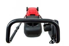 Nowy czerwony lawnmower na białym tle Obrazy Stock