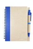 Nowy notatnik z błękitnym piórem Obraz Royalty Free