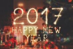 Nowy rok chrzcielnicy sparkler liczby na izbowym tle Obrazy Royalty Free