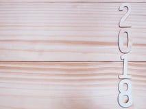 2018 nowy rok drewniana liczba na drewnianym tle Fotografia Royalty Free