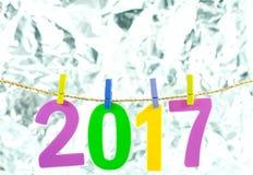 Nowy Rok 2017 liczb na blond tle Zdjęcia Stock