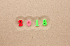 Nowy rok 2018 pisać w piasku Obrazy Stock