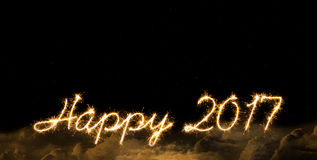 Nowy Rok 2017 sparkler podpisuje wewnątrz chmurnieje Zdjęcie Royalty Free