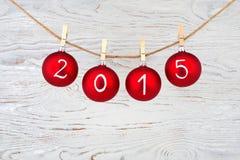 2015 nowy rok tekst na bożych narodzeń baubles Fotografia Royalty Free