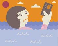 Noyade sur la dette de carte de crédit Photo stock