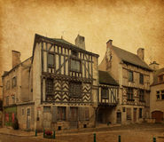 Noyers. Ancient architecture of  Noyers, , Burgundy, France. Photo in retro style. Added  paper texture Stock Photo