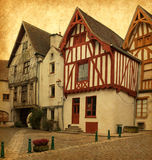 Noyers. Ancient architecture of Noyers, Burgundy, France. Photo in retro style. Added paper texture Royalty Free Stock Image
