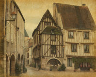 Noyers. Centre place in Noyers, Burgundy, France. Photo in retro style. Paper texture Stock Photography