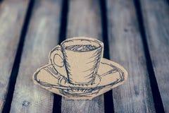 Noyez la tasse de faux café images stock