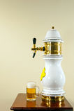 Nozzle and beer pint Royalty Free Stock Photos