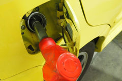 Nozzle fuel Gasohol serving in to the car at petrol station Royalty Free Stock Image