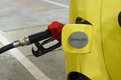 Nozzle fuel Gasohol 95 serving in to small car Stock Images