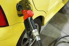 Nozzle fuel Gasoline serving in to the small car Royalty Free Stock Photography
