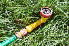 Nozzle for garden hose. Lying on the lush green grass uncut stock photo