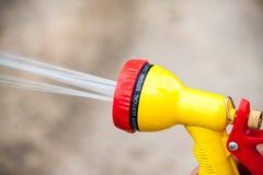 Nozzle for garden hose. Water jet from a garden hose nozzle stock photos