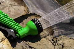 Nozzle on a garden hose for watering. The Garden hose nozzle for irrigation royalty free stock image