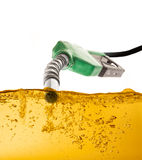 Nozzle and Gasoline. Nozzle pumping gasoline in a tank Stock Photo