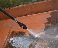 Nozzle of high pressure washer in use royalty free stock images