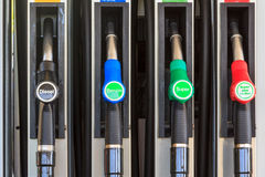 Nozzles on a gas station. Four nozzles on a gas station in Austria, Europe offering diesel and super benzine Royalty Free Stock Images