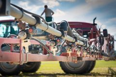 Nozzles On The Spray Bar, Against The Background Of The Sprayer And The Person Standing On The Barrel, During Refueling Royalty Free Stock Photos