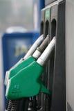 Nozzles at a petrol station Royalty Free Stock Image