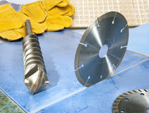 Nozzles for the puncher and a detachable diamond disk on a tile. stock photos