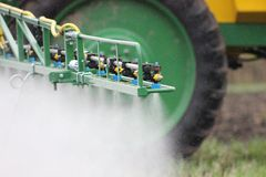 Nozzles spraying Stock Images