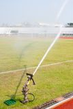 Nozzles are watering the field. Care watering soccer fields Royalty Free Stock Image