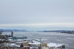 Panorama of frozen Saint Lawrence river fleuve Saint Laurent in Quebec city during a winter afternoon. NPicture of the coast of Quebec on Saint Lawrence river royalty free stock photos
