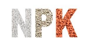 NPK信件由矿物肥料制成 免版税库存照片