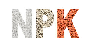 NPK letters made of mineral fertilizers. On the white  background. N - nitrogen, P - phosphorus, K - potassium (kalium Royalty Free Stock Photo