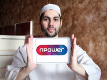 Npower energy company logo. Logo of energy and home services company npower on samsung tablet holded by arab muslim man stock photos