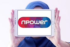 Npower energy company logo. Logo of energy and home services company npower on samsung tablet holded by arab muslim woman royalty free stock photography