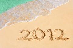 Nr. 2012 auf Strand Stockfotografie