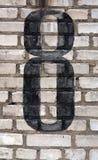 Nr. acht auf Backsteinmauer Lizenzfreies Stockbild
