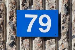 Nr. 79 auf blauem blate Lizenzfreies Stockbild
