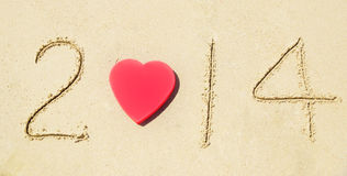 Nr. 2014 auf sandigem Strandurlaubkonzept Lizenzfreie Stockbilder